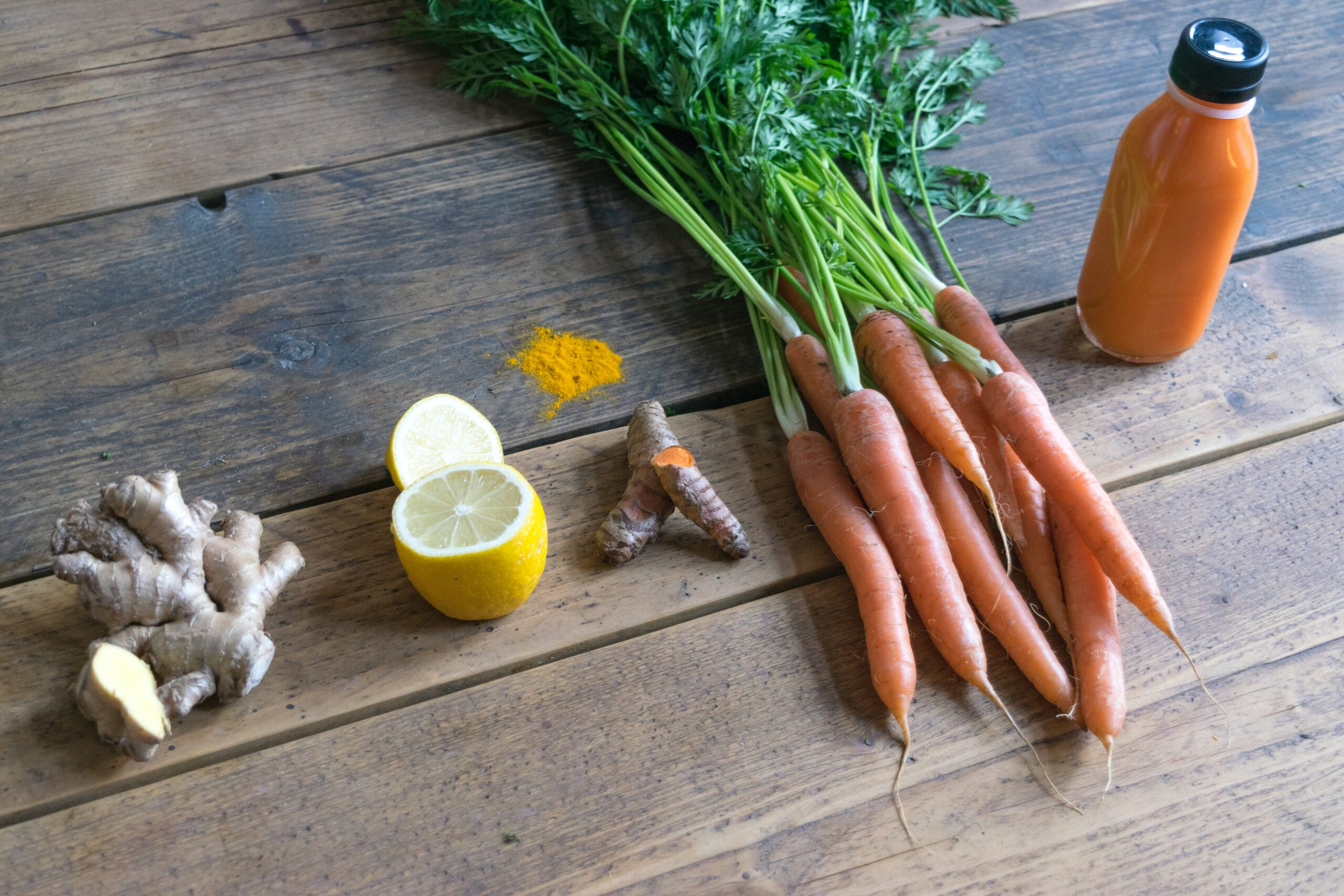 Ginger, turmeric, lemon and carrots made into a juice